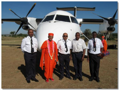 Acharya Swamishree with the pilot and the cabin crew