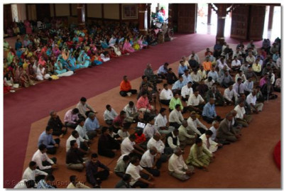 Devotees listen to the divine blessings