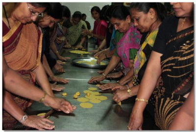 Devotees preparing prasad