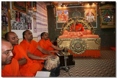Acharya Swamishree and sants performing the Kirtan Bhakti niyams
