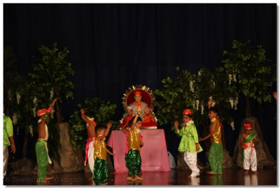 Young devotees take part in the dance