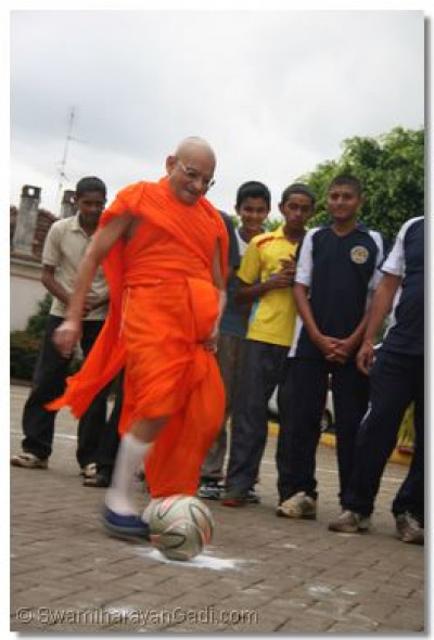 Acharya Swamishree kicks off the game of Football