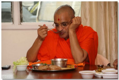 Acharya Swamishree having prasad