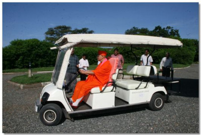 Acharya Swamishree drives around the Lodge  in a golf cart