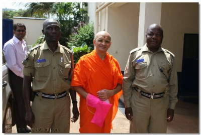 Acharya Swamishree with the officers in charge of police escort