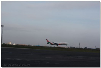 Kenya Airways plane carrying HDH Acharya Swamishree about to land at Jomo Kenyatta International Airport (JKIA)