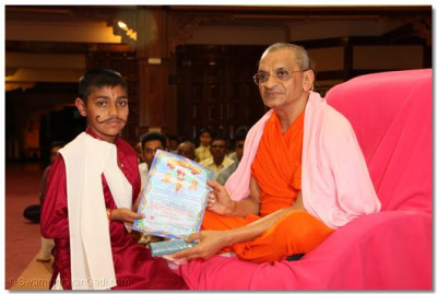 A devotee collects his certificate - primary level