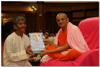 A devotee collects his certificate - Key Stage 2