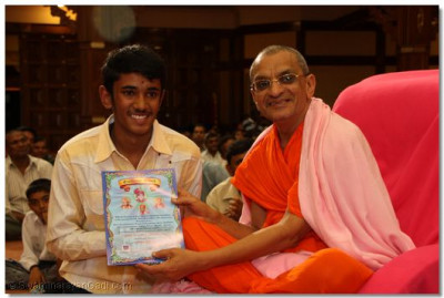 A devotee collects his certificate - 'O' levels