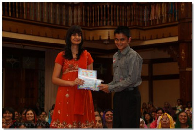 A devotee collects her certificate - 'O' levels