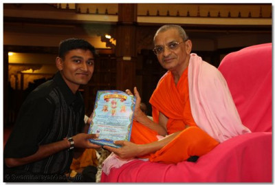 A devotee collects his certificate - Diploma