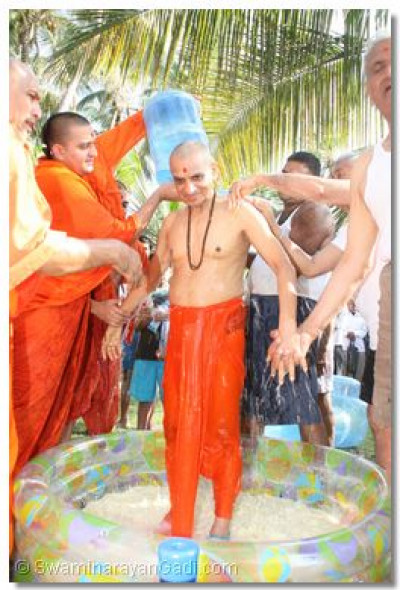 Panchamrut snan ceremony performed by disciples
