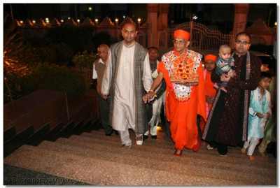 Disciples lead His Divine Holiness Acharya Swamishree and Shree Harikrishna Maharaj into Shree Swaminarayan Temple Nairobi