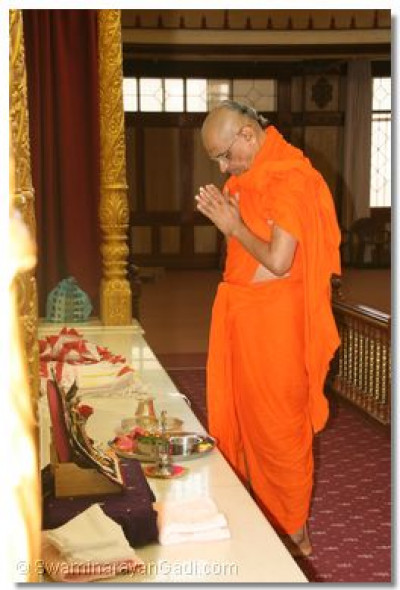 His Divine Holiness Acharya Swamishree performs poojan during the 11th Anniversary ceremony