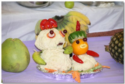 Two small characters created skilfully using raw fruits and vegetables foms part of the ankot