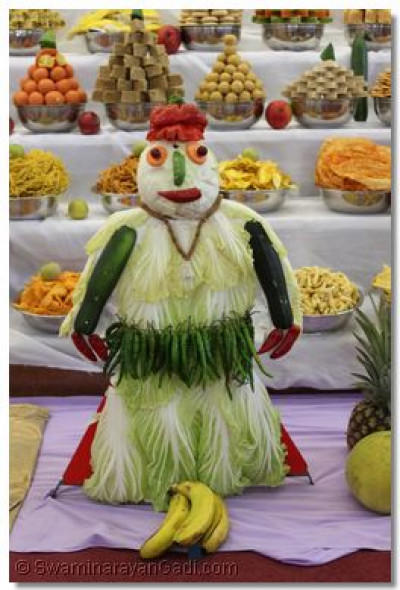 A miniature disciple skilfully crafted using raw vegetables forms part of the ankot