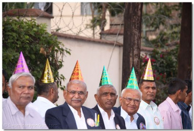 feeling happy with their Birthday hats on