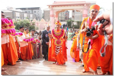 HDH Acharya Swamishree approaches the temple hall entrance