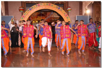 A welcome dance by devotees at the temple hall entrance