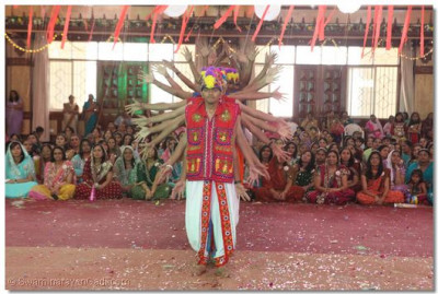 Young devotees perform a dance