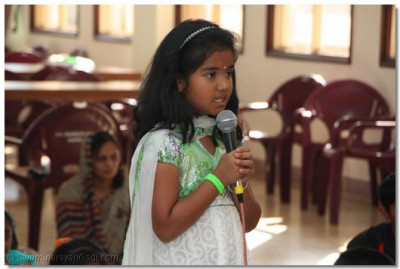 A young student sings prarthna kirtan