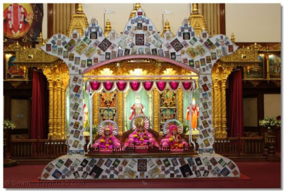 Hindola decorated with holy books published by Shree Swaminarayan Gadi Sansthan