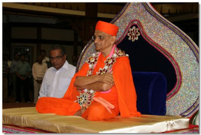Divine darshan of His Divine Holiness Acharya Swamishree seated at the centre of Shree Swaminarayan Temple Nairobi as disciples play raas