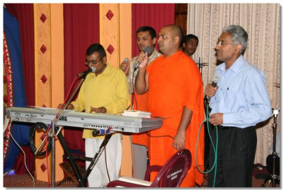 Sants and disciples sing traditional devotional songs during the raas