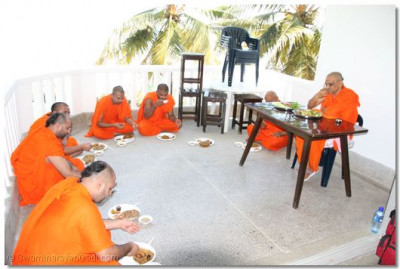 Acharya Swamishree and sants taking lunch time prasad