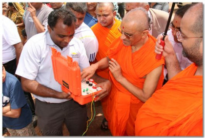 Acharya Swamishree activates the bomb device for the demolition