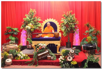 HDH Acharya swamishree surrounded by musical instruments