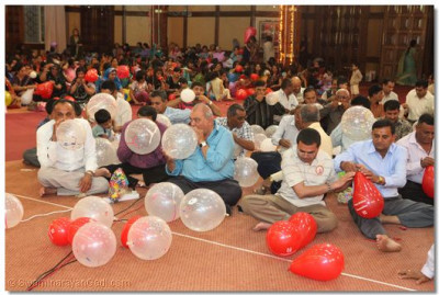 Devotees blow baloons in readiness for birthday celebrations