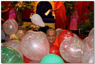 HDH Acharya Swamishree surrounded by baloons