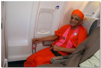 HDH Acharya Swamishree in the plane