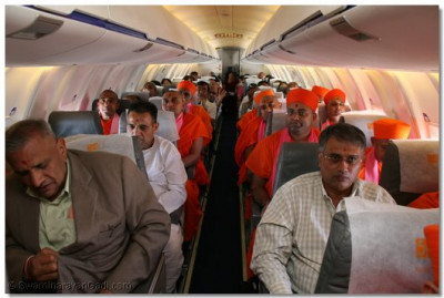 Sant mandal and devotees in the plane