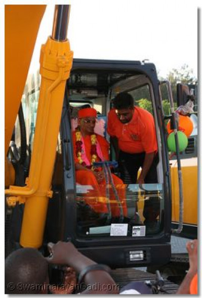 Acharya Swamishree performs poojan to one of the transport equipments