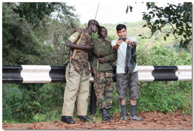 A devotee with the patrol team at the Karuma Bridge