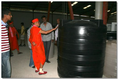 The final product -  Acharya Swamishree carrying out a quality check at the plant