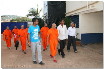 HDH Acharya Swamishree and devotees going for a padharamani at a pipe manufacturing factory