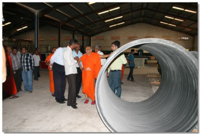 Water pipes being manufactured at the disciple's factory being shown to HDH Acharya Swamishree