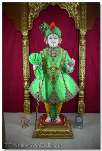 Lord Swaminarayan adorned in gem-stone attire
