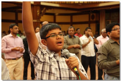 A young devotee roars victory slogans