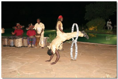 An African group of dancers and acrobats entertain the spectators
