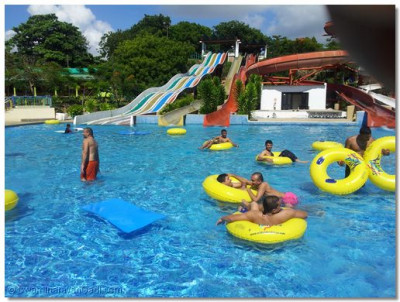 Sants and devotees enjoying at a water park, Wild Waters