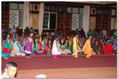 Young girls perfom to 'Swamibapa no Ladko Dikro' during the welcome ceremony in the evening