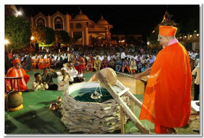 Drawing water from the well is not an easy task, but His Holiness does it with ease