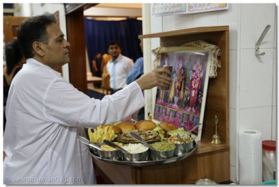 Mahaprasad being offered to Ghanshyam Maharaj