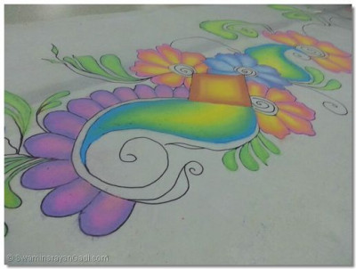 Close up of the colourful chalk rangoli.