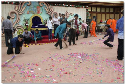 Devotees cleaning after the New year celebration.