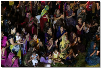 Devotees being showered with sacred water.